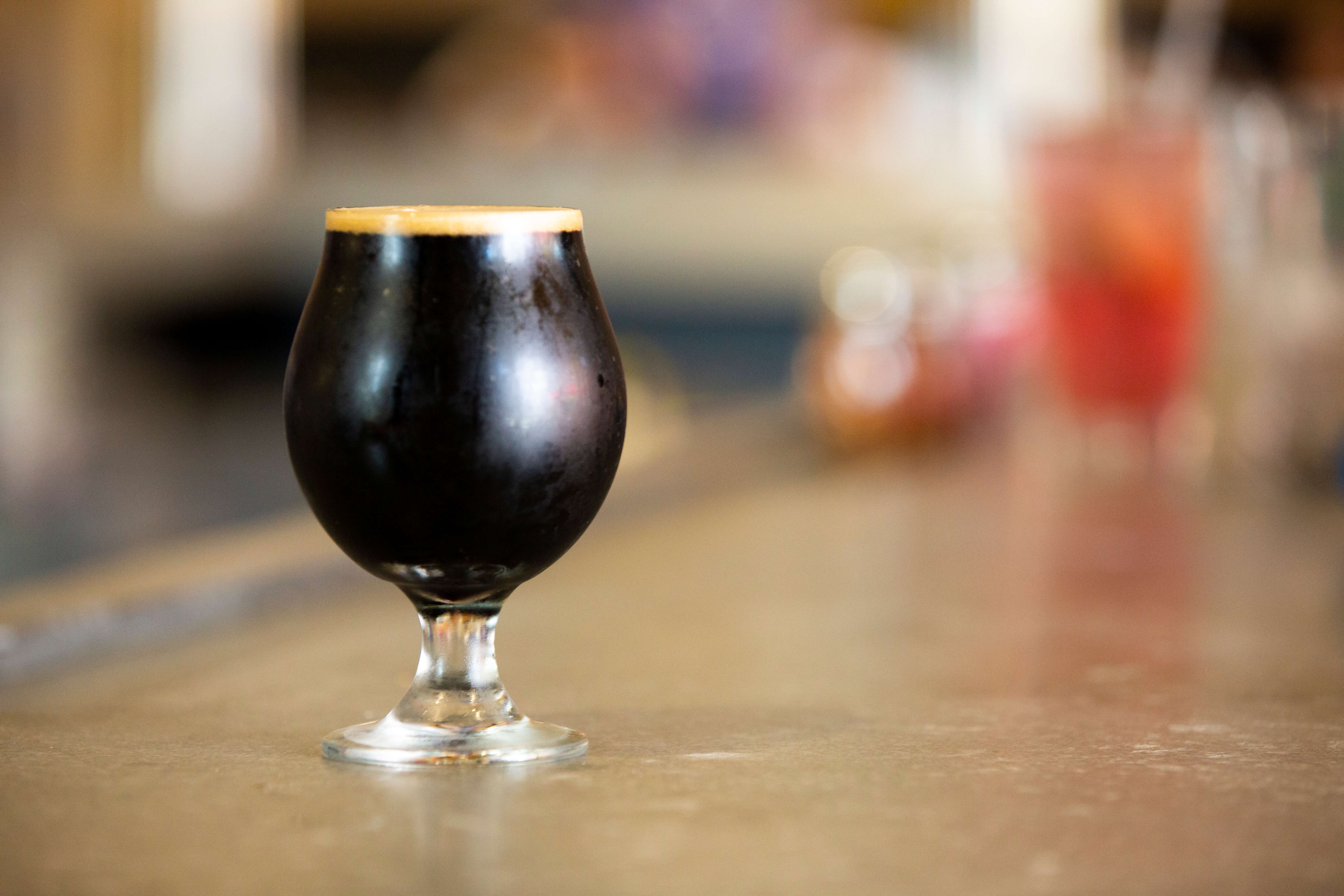 Dark beer in glass on counter